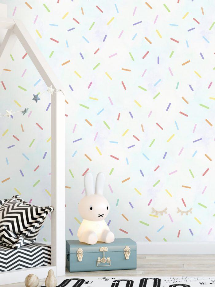Papel de parede granulado colorido com fundo azul na decoração infantil